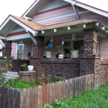 512 Morgan Street. Built between 1915-1923. Style: Craftsman bungalow. Base is clinker brick. Siding added later.