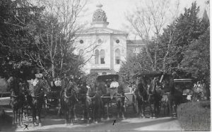 Horse and buggy rigs for mail, school in front of Ursuline 1908